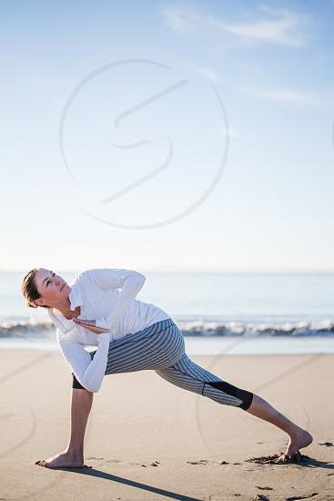 beach sun salutations yoga woman girl morning exercise workout happy beauty soul mind photo