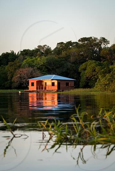 Canoeing nearby the Amazon River around Juma Lake and came across this little cabin by the water right at sunset. photo
