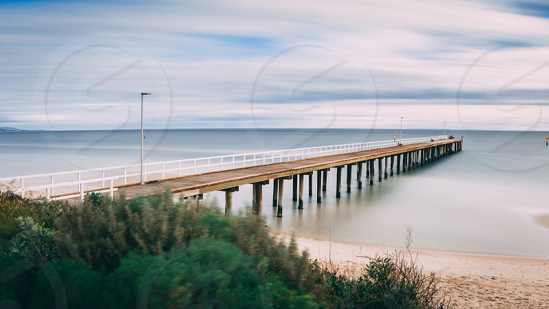 Seaford pier pier water bay Port Phillip Bay victoria Melbourne Australia long exposure Lee Filters ND filter silky water smooth smooth water beach fauna pylon sky clouds streaky clouds Ian Jones Photography Seaford suburb local wood wooden pier wooden structure  photo