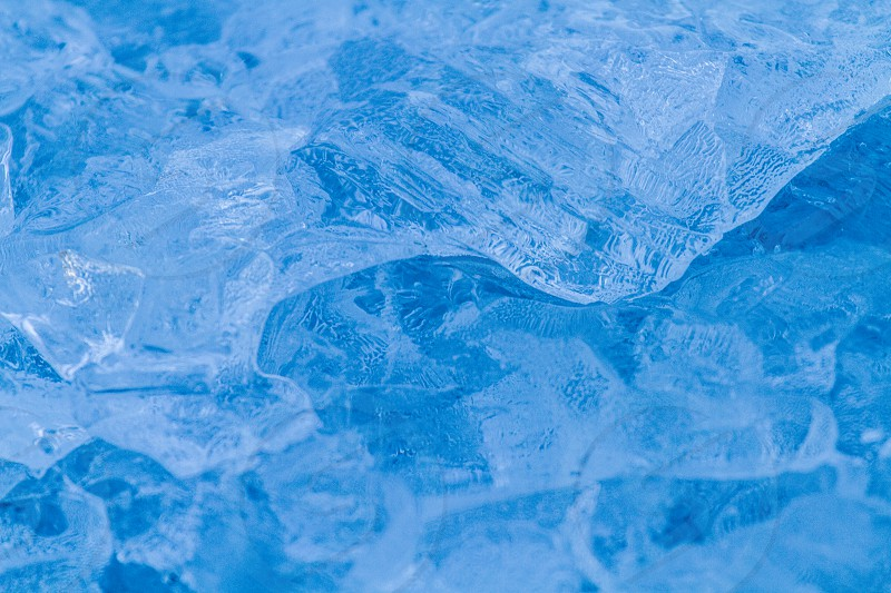 The blue ice of a glacier photo