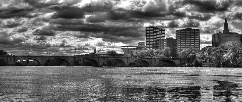 Hartford Connecticut building skyline with storm moving in.  Connecticut River in the foreground photo