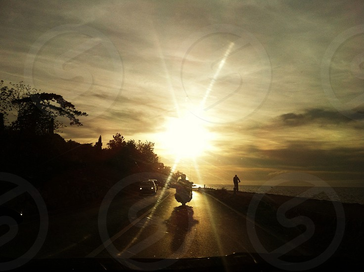 man in motorcycle sihouette photo