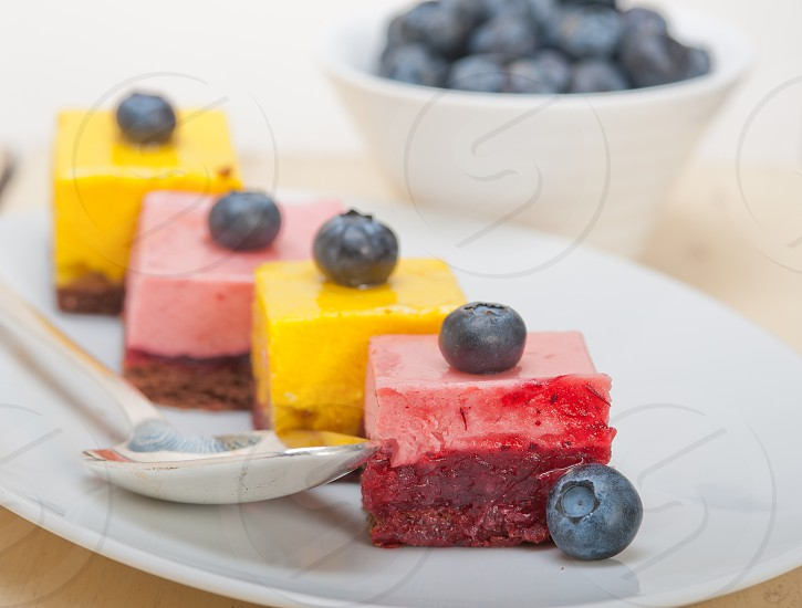 fresh strawberry and mango mousse dessert cake with blueberry photo
