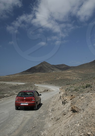 The Road in the Jandia Natural Parc on the south of the Island Fuerteventura on the Canary island of Spain in the Atlantic Ocean. photo