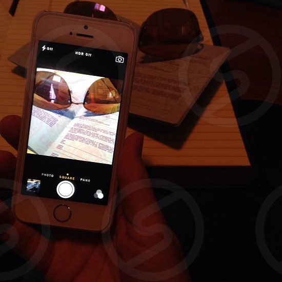 Passport; smartphone; photo; sunglasses; photo