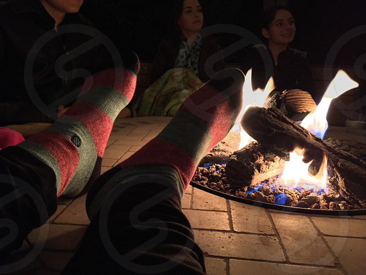 people gathering around bonfire photo