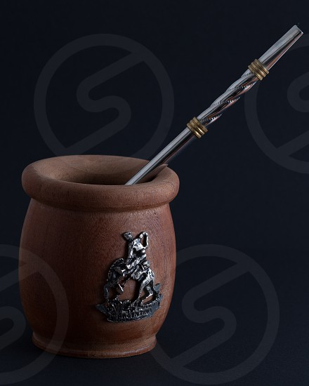 mortar and pestle on black surface photo