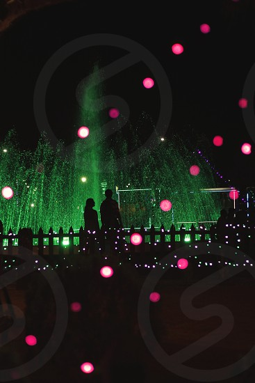Silhouette of a couple spotted in Eco Park Kolkata along with the lights. photo