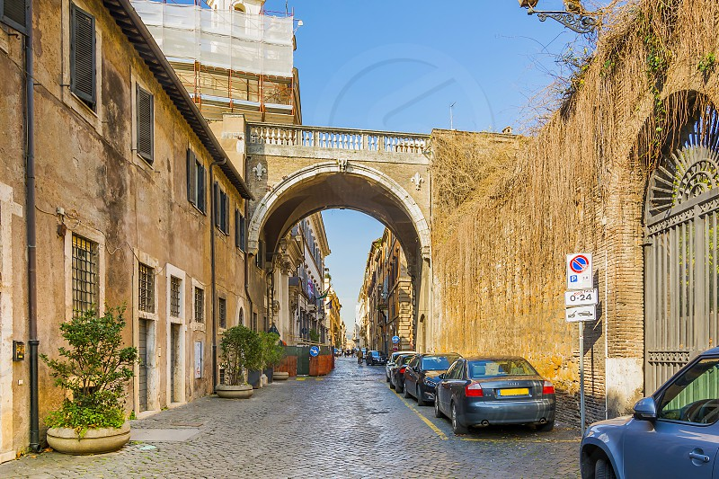 the ancient Farnese arch in Via Giulia. Via Giulia is a street in the historic centre of Rome. It was one of the first important urban planning projects in Renaissance Rome photo