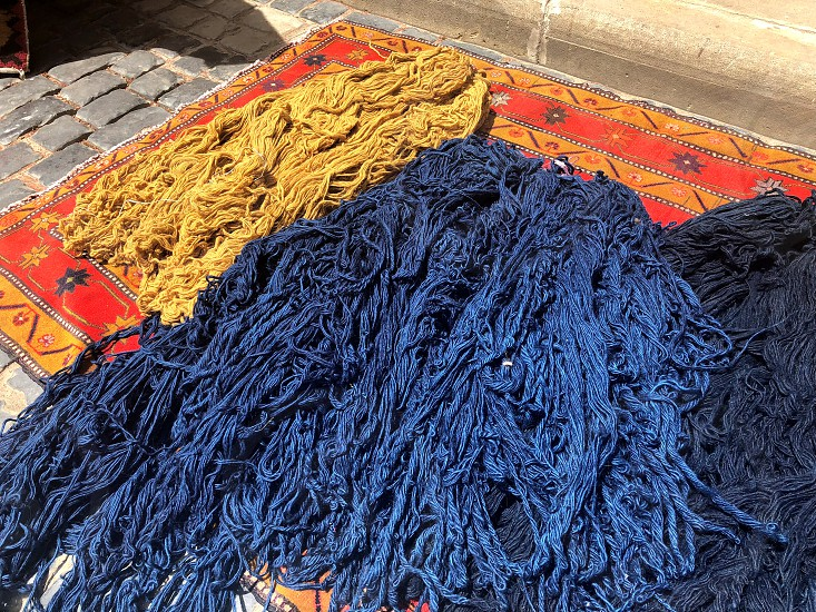 Multi-colored woolen threads for knitting carpets. Carpet. Beautiful landscape.  photo