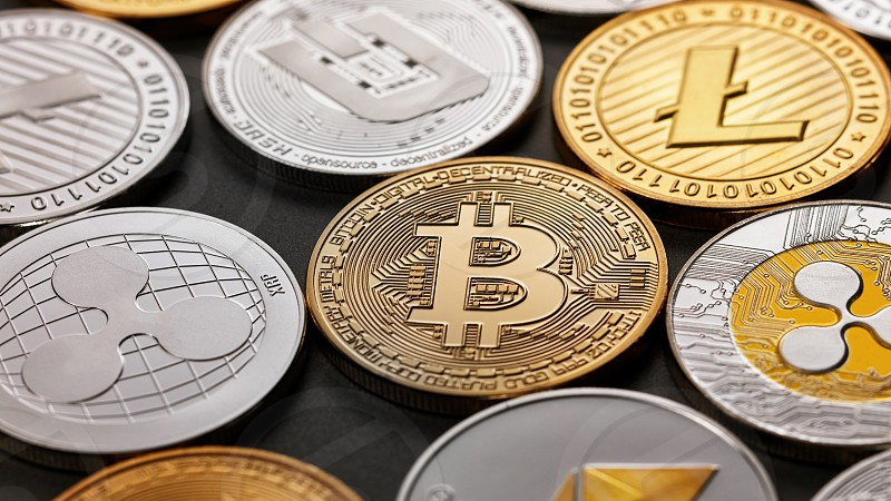 Coins of crypto currency bitcoin ethereum litecoin monero ripple dash on a dark background a pattern of coins. Business finance and technology concept. photo