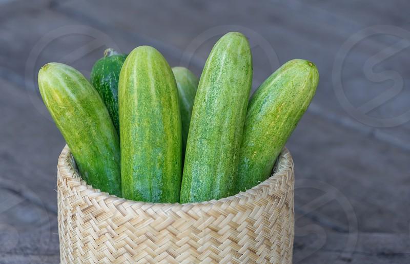 Bitter gourds in a wickerwork basket. photo