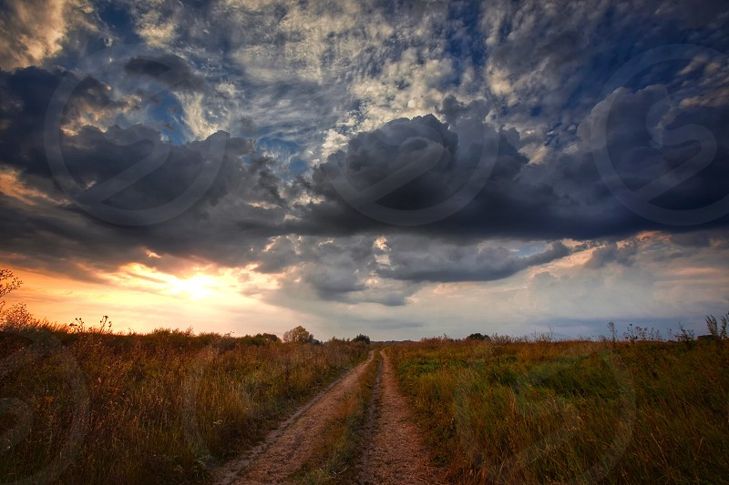 Landscape travel sky nature sunset sunrise morning early night evening autumn clouds light sunshine wheat rye field countryside rural Russia  thunder  road photo