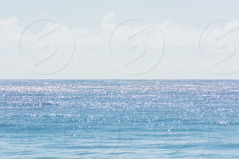 water sky sparkles sparkly sparkling blue white clouds serene sunny photo