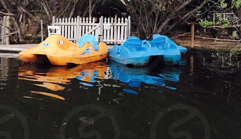 two yellow and blue pedal boats near on dock photo