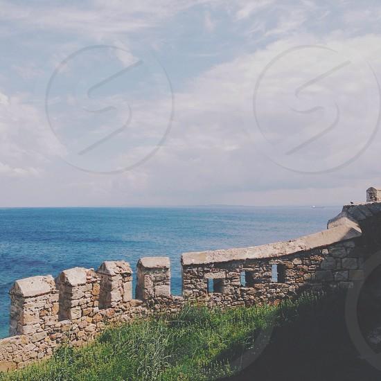 brown stone walled beach view photo