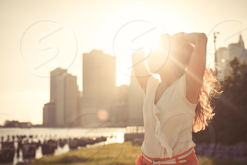 Woman lifestyle sun summer lens flare young attractive photo