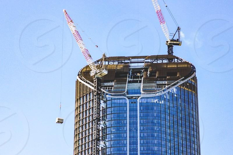 construction work on a skyscraper crane building photo