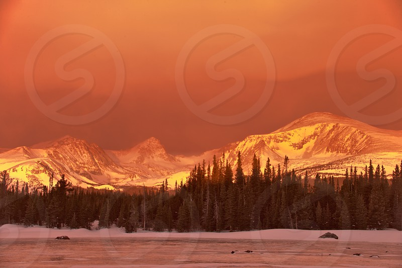 colorado; indian peaks; nederland; off the beaten path; squall; winter snow peaks mountain mountains wilderness area wilderness blustery pink sunrise photo