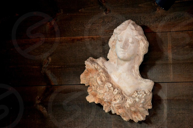 white ceramic human figurine photo