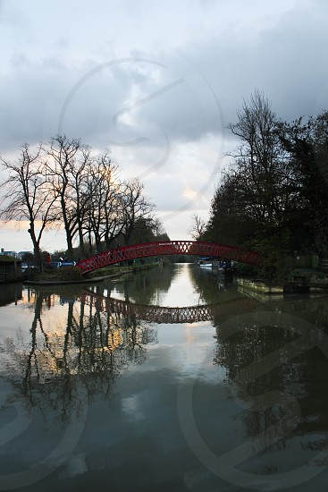 Red bridge and reflections port meadows oxford photo