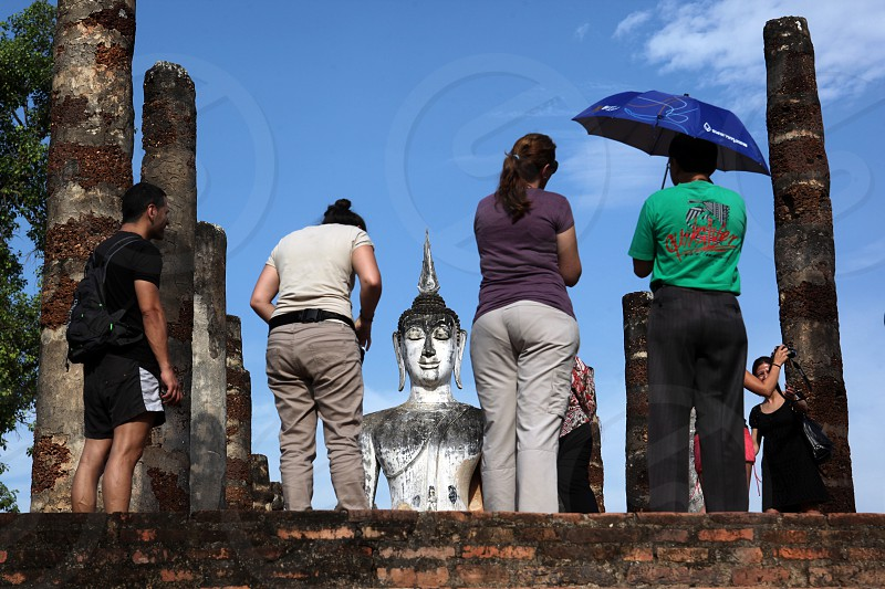 a Buddha at the Wat Mahathat Temple in Sukothai in the Provinz Sukhothai in the north of Bangkok in Thailand Southeastasia. photo