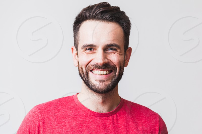Portrait of a handsome young man smiling photo