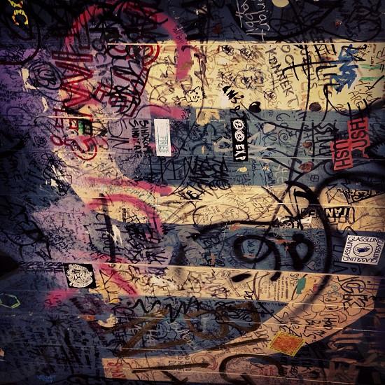 assorted graffiti on gray wall photo