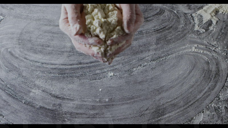 Splash from flour. Woman's hands throw the heap of aflour on a wooden table. Top view. Slow motion Full HD video 240fps 1080p. Step by step homemade dough preparation. photo
