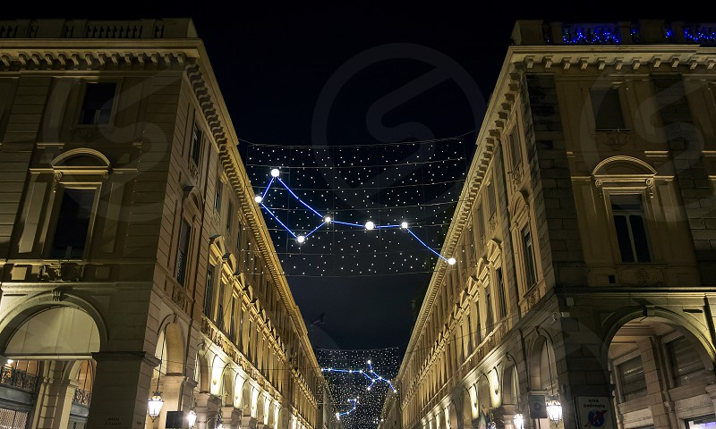 Christmas lights in Turin with constellations and astronomy theme. Night outdoor shot photo