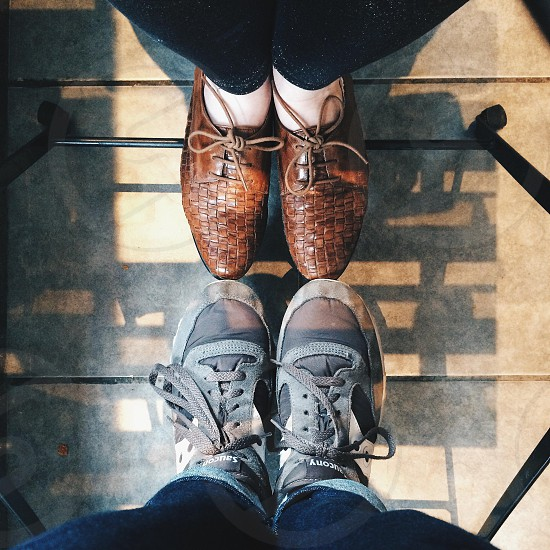 2 person's feet together photo
