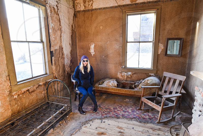 dilapidated interior young woman messy bedroom photo