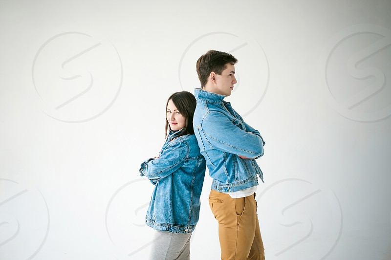 young couple man and woman in trendy jeans clothes studio shot on white background photo