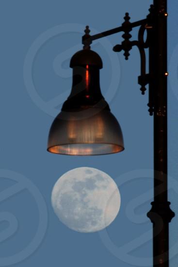 Full moon above a public light photo