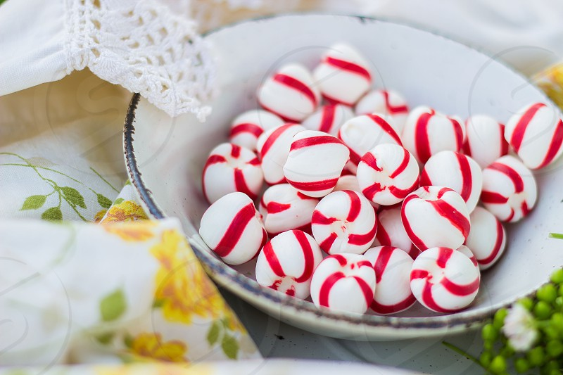 white round candy with red stripe design photo
