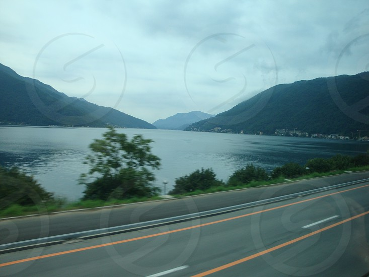 gray cemented road near the sea photo