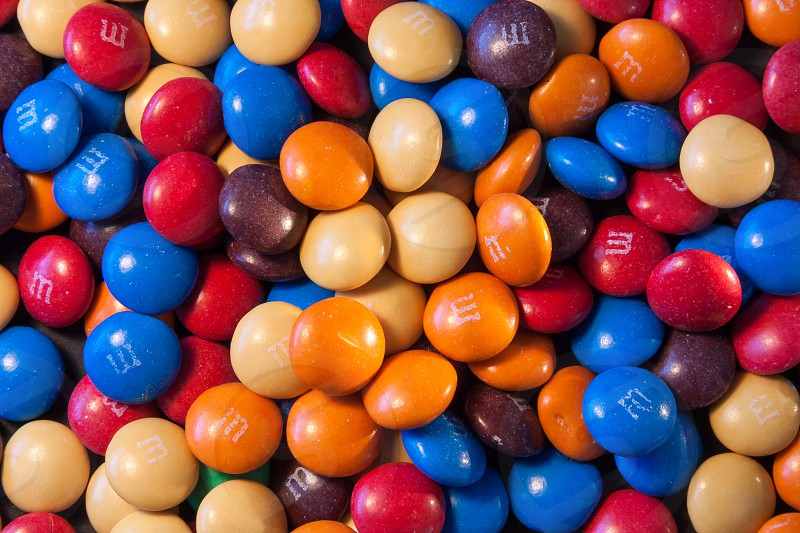 EAST GRINSTEAD WEST SUSSEX/UK - MARCH 5 : Close-up of some multicoloured M&Ms sweets in East Grinstead on March 5 2008 photo