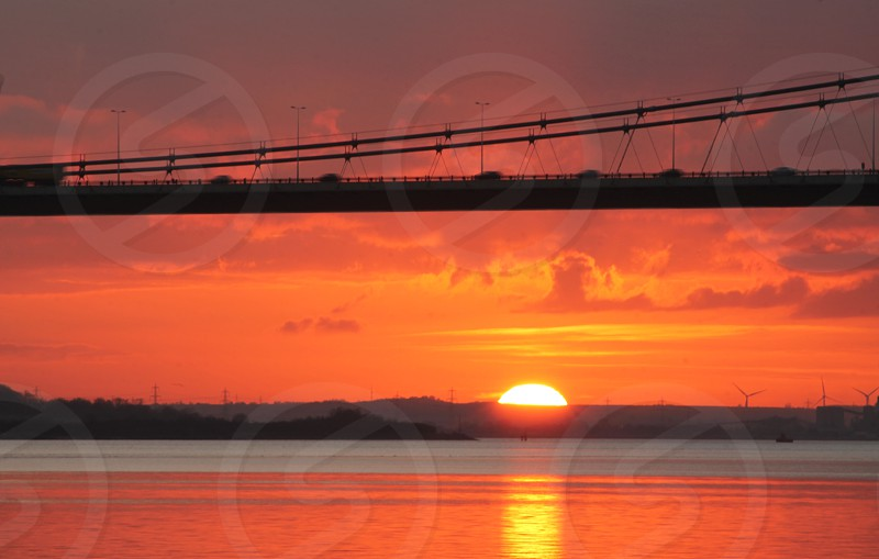 Moving cars and Trucks on the Humber Bridge Hull Yorkshire at sunset photo