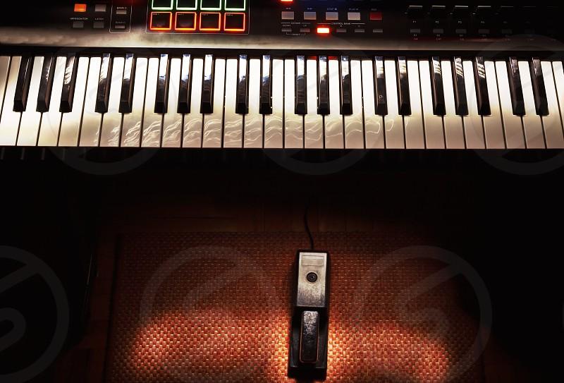 Mini home studio midi controller and sustain pedal. photo