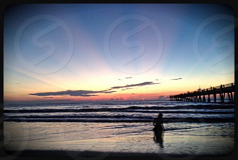 woman in water at sunrise photo
