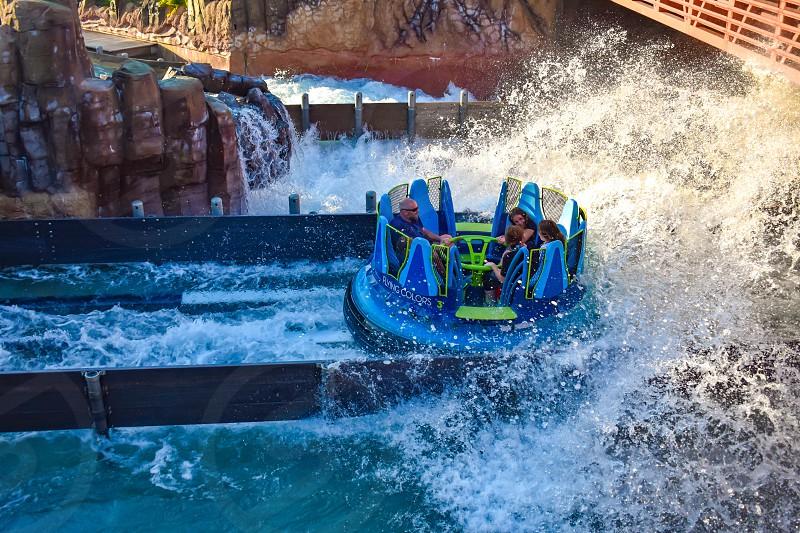 Orlando Florida. March 09 2019 People having fun Kraken rollercoaster at Seaworld Marine Theme Park (1) photo