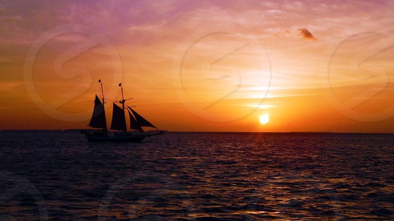Sailboat at sunset near Key West FL photo