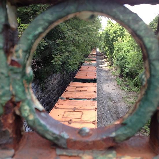 Box car boxcar train looking through ironwork iron circle bridge  photo