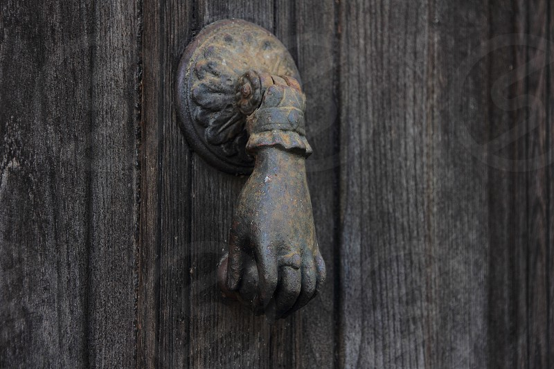 Old door with door knocker photo