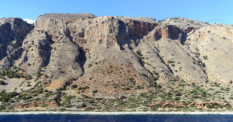 panoramic image of Crete (Greece) mountains of Libyan Sea side. driving with a boat along from Samaria gorge towards Loutro village. made of 5 images.     photo