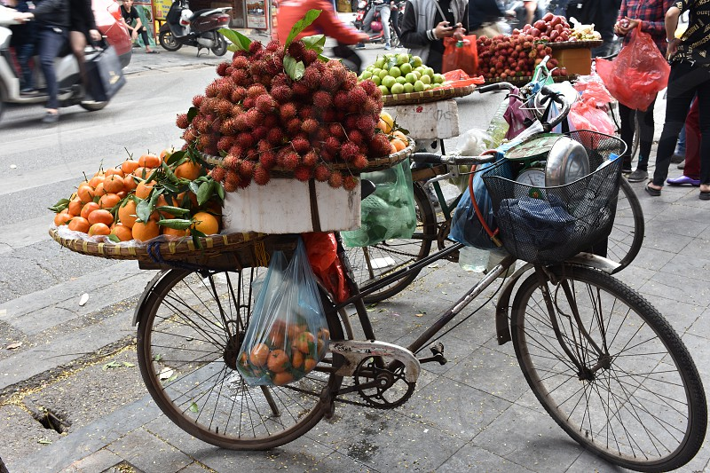 Bicycle carry full of fruit for sale in Hanoi Vietnam photo