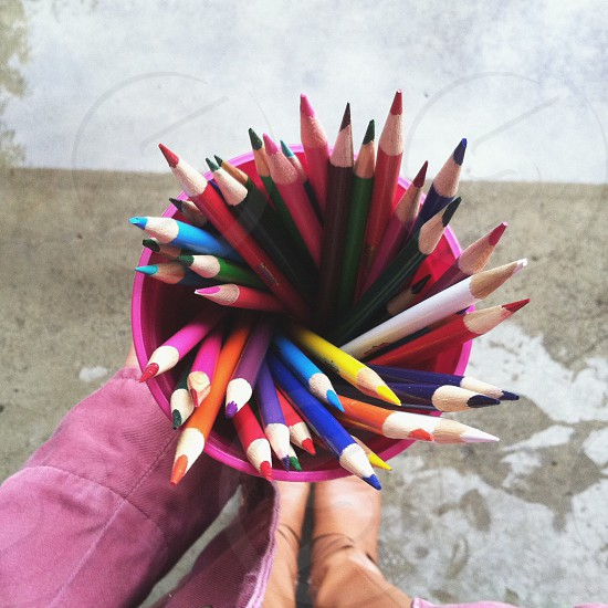 coloring pencils on pink plastic container photo