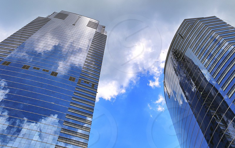 Reflection  sky clouds city building  photo