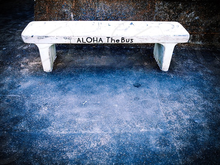 white concrete outdoor bench photo