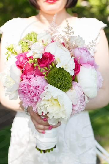 woman holding bouquet photo